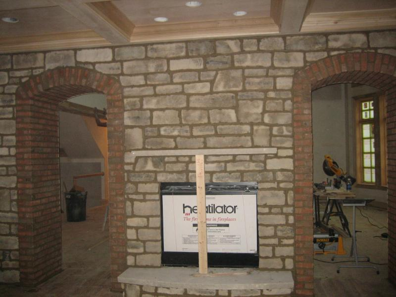 Brick Arched Doorways and Stone Fireplace